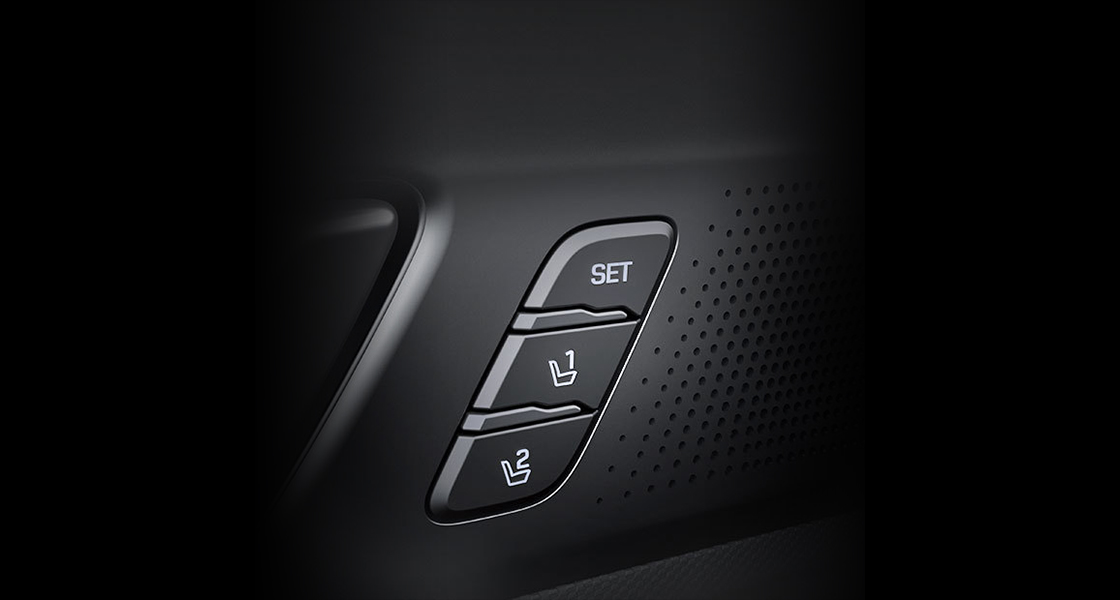 Integrated memory seat control buttons