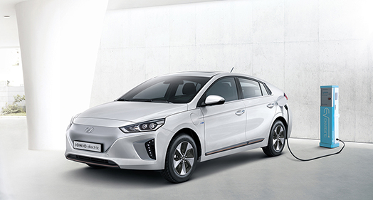 Side front view of Ioniq electric getting charged